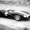 """Chuck Dietrich at Virginia International Raceway, April 1963 SCCA Nationals.<br /> Photo by Jack Upchurch from <br /> <a href=""""http://www.virhistory.com/vir/63-apr/63-apr-du.html"""">http://www.virhistory.com/vir/63-apr/63-apr-du.html</a><br /> <br /> """"Chuck Dietrich manned the American-made Bobsy II and led the GM gang from the start but it was Dr. M.R.J. Wyllie's Lola with a first-lap five-second lead which built up into something quite uncatchable to second overall. Oil spillage on the clutch took care of the good doctor's sure win and after a carbon tet spray fest in the pits, he zoomed out in pursuit of the now leading Bobsy and Tweedale's Lola, with Wyllie picking up 20 healthy seconds in the next two laps. So it rests after two nationals-Wyllie lost this one and Bobsy and Lola are tied for first. Not bad for the Bobsy's first serious debut (Dietrich commented it's an 'awful hard car to drive.')""""<br /> Race report from <br /> <a href=""""http://www.virhistory.com/vir/63-apr/63-tms.htm"""">http://www.virhistory.com/vir/63-apr/63-tms.htm</a><br /> <br /> """"After lunch the Juniors and III's challenged the G modifieds, with a Junior taking the cookies. Charlie Hayes had settled down to a sure second overall when the leading Lotus 22 of John Henderson spun into the woods at Oak Tree 3 laps from the finish. The Elva then scooted home ahead of Chuck Dietrich's Bobsy and the Lolas of Art Tweedale and Doc Wyllie. J.W. Gadwa's Cooper XI took F III, and then  ran out of gas on the victory lap.""""<br /> Race report from <br /> <a href=""""http://www.virhistory.com/vir/63-apr/6304-bk-report.htm"""">http://www.virhistory.com/vir/63-apr/6304-bk-report.htm</a>"""
