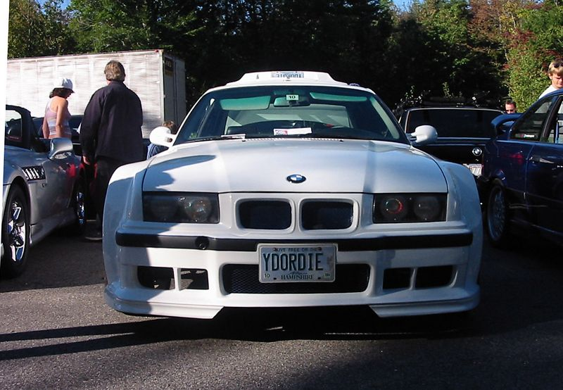 "E36 318is (yes, 318is). Rennsport wide body kit; stock interior with a white ""Isetta"" steering wheel; wheels with huge spacers; STOCK single-tip muffler. Hopefully a work in progress... I had high hopes for this car when it pulled up."