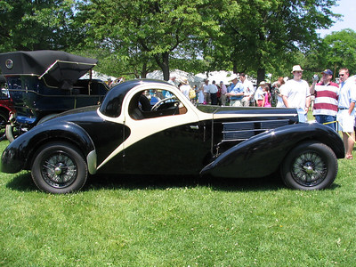 Bugatti Type 57C Atalante. Locked away in a New York barn for 45 years, this car was sold at a Greenwich auction in 2007. It is in the same condition as it was when stored in 1962. The car was inspected by a Bugatti specialist and nearly all of the original and correct parts were still present. It is a true time-capsule car that can now be used as a benchmark for every future Type 57 restoration. Bravo!  http://www.bugattipage.com/newspics/57766.jpg