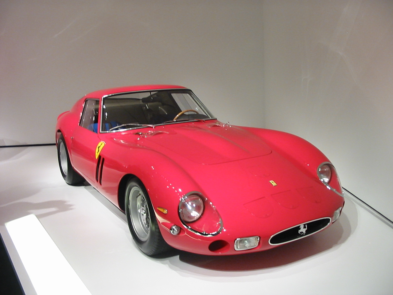 Ferrari 250GTO. First raced by the Rodriguez brothers at Montlhery in 1962 under N.A.R.T. ownership (first overall). Then it was owned by the Mecom Racing Team from Texas and driven by Roger Penske and Augie Pabst to numerous first place finishes around the US. From 1972 on it has been a frequent Concours entrant under several owners including the current one, Ralph Lauren.