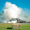 Aaron Francis in his Nissan Skyline 'NISMO' 6 cyl sedan on the Emerald burnout pad. Car is stock standard.