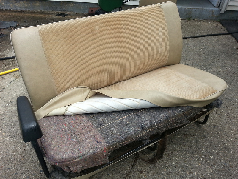 Middle 2/3 seat with seat cover partially removed. Bottom was preserved for pattern. Padding is original. Seat back not removed.