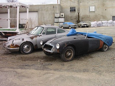 Peabody, MA. Saw these 2 beauties from the road when driving through Peabody. I turned around and when I pulled in there were 5 more cars in similar condition behind these. This is a Porsche 911 and an Austin-Healey 1600.