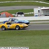 Howard Cohen # 69 - 2012 VARAC Del Bruce at Mosport 02 passing Boris Tirpack