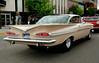 Light pink Chevy Impala