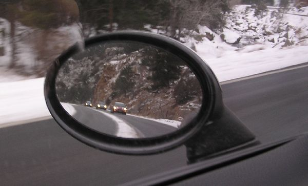 A few MINIs in my side view mirror. The line of ninie MINIs stayed together almost the entire trip!
