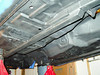 The underside after stripping to bare metal. I welded in the sub-frame connectors and have it all under primer.
