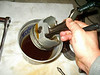 Dunking the whole piston in a bucket of oil.
