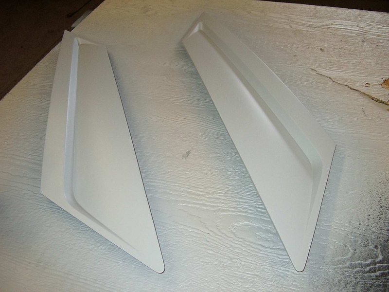Got my hands on a nice pair of SVO sail panels also primed and ready for paint.