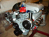 Polished alternator, belt tensioner and power steering bracket and an MSD cap and rotor.