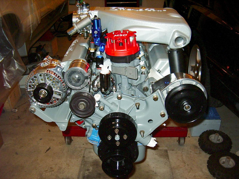 Got the accessories, distributor, fuel rails, intake, sensors, upper intake and headers on.<br /> NOW it looks like a beast!