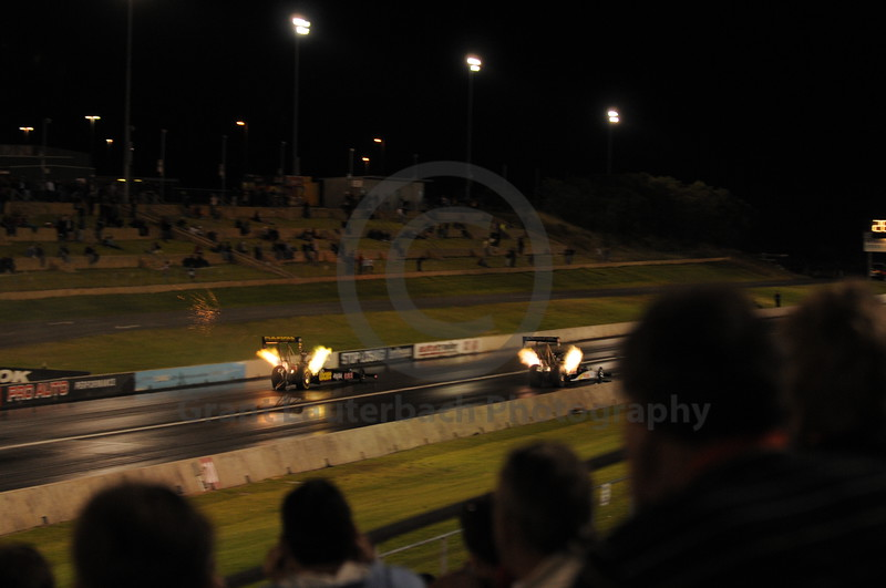 Top Fuel Dragster racing at the Quit Motorplex in Kwinana Western Australia. Sparks flying from the exhaust just before a major explosion in the engine.