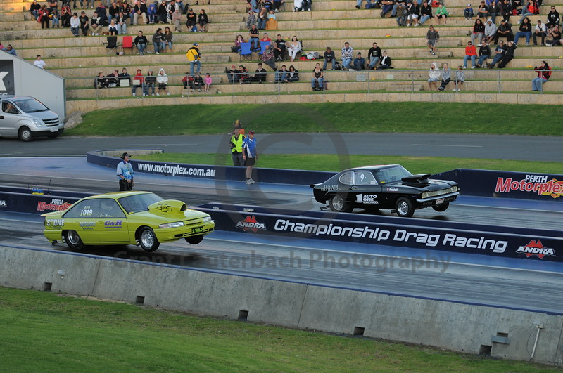 Drag racing at the Quit Motorplex in Kwinana Western Australia. These guys are tyring out for the high jump in the next Olympics.