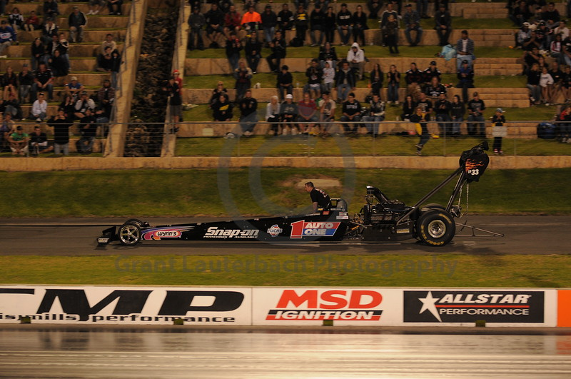 Top Fuel Dragster racing at the Quit Motorplex in Kwinana Western Australia. Dragter being towed back to pits on the return road.