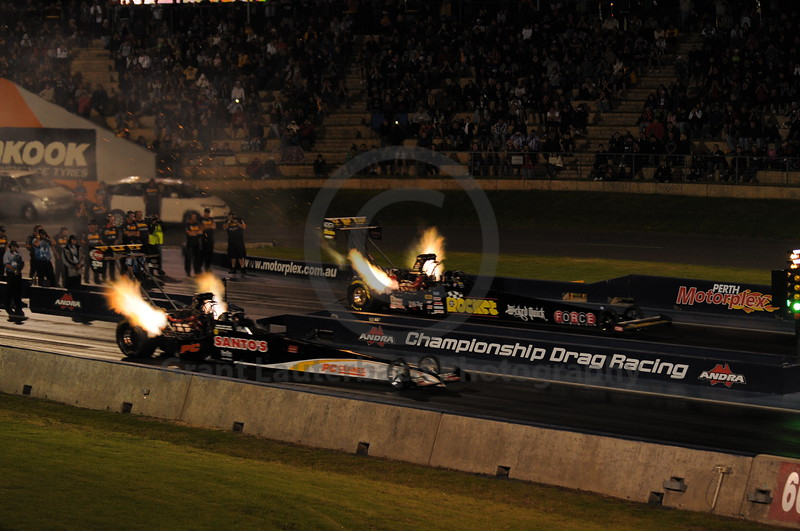 Top Fuel Dragster racing at the Quit Motorplex in Kwinana Western Australia. Some serious amount of debris leaving the exhaust of the Rocket dragster. A far more serious explosion happend about 300 meters down the track.