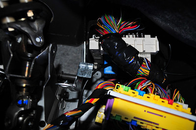 Dash harness main disconnect, auxiliary relay box. Steering column on left.