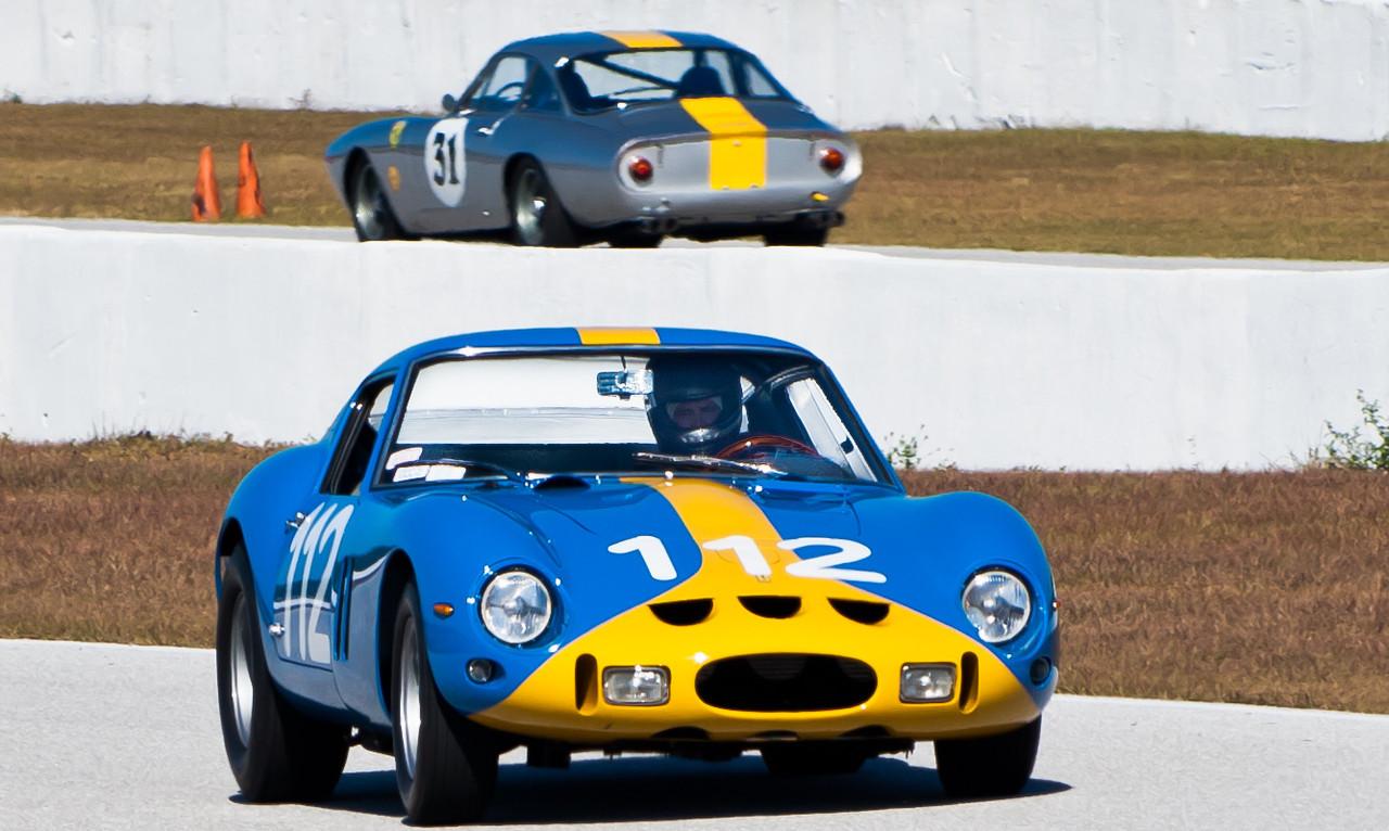 Chris Cox in 1962 Ferrari GTO in foreground, Peter Giddings in 1962 Ferrari 250 GT Lusso in back