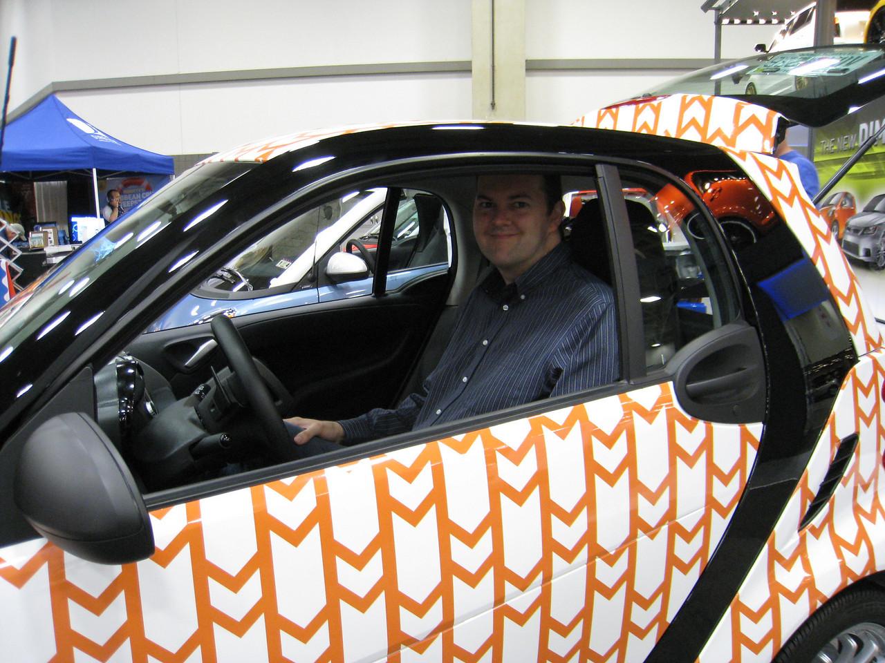 Myself sitting in a smart car