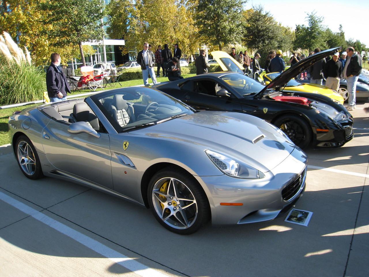 Ferrari GT California (gray) next to a Ferrari 599 GTO (black)