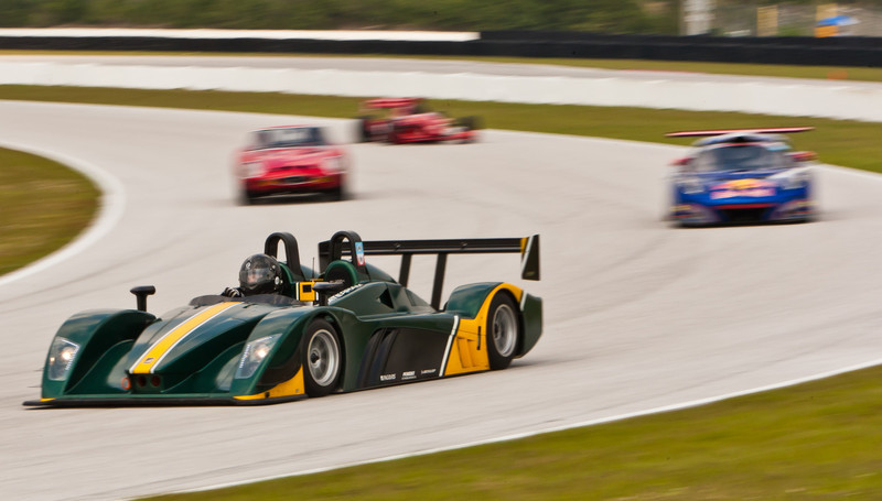 Caterham SP 300R leads Lotus, Ferrari 250 GTO and Indy Car into Turn 5