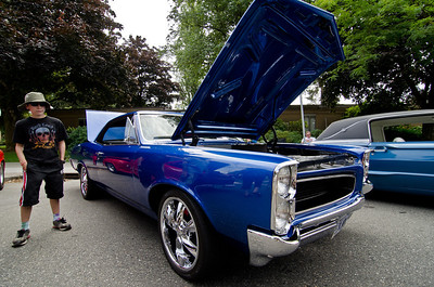 A 1966 Pontiac GTO.  And a cool kid...in a hat.