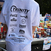 "Cars & Cans Car Show, organized by 16-year-old Alex ""Slimey"" Lambert of Dracut, to collect food and raise money for the Dracut Food Pantry. Tee shirt he's wearing lists the event's sponsors. (SUN/Julia Malakie)"