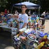 "Cars & Cans Car Show, organized by 16-year-old Alex ""Slimey"" Lambert of Dracut, to collect food and raise money for the Dracut Food Pantry. Lambert with food that had been contributed by about 1pm. (SUN/Julia Malakie)"