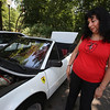 "Cars & Cans Car Show, organized by 16-year-old Alex ""Slimey"" Lambert of Dracut, to collect food and raise money for the Dracut Food Pantry. Gloria Sesin de Contreras of Windham, N.H, with her 1984 Ferrari. He husband bought it for her new and she's had it since. (SUN/Julia Malakie)"