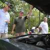 "Cars & Cans Car Show, organized by 16-year-old Alex ""Slimey"" Lambert of Dracut, to collect food and raise money for the Dracut Food Pantry. From left, Steve Masse, Tom Sawyer and Robert Morel, all of Dracut, look under the hood of the 1985 Buick LeSabre Limited Edition Sawyer just bought a week ago with 12,000 miles on it. Masse and Sawyer are both members of the Dracut Roadrunners Club. Morel is not, but now plans to join. (SUN/Julia Malakie)"