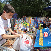 "Cars & Cans Car Show, organized by 16-year-old Alex ""Slimey"" Lambert of Dracut, left, to collect food and raise money for the Dracut Food Pantry. This was food donated today. (SUN/Julia Malakie)"