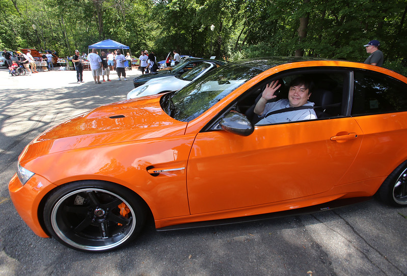 "Cars & Cans Car Show, organized by 16-year-old Alex ""Slimey"" Lambert of Dracut, to collect food and raise money for the Dracut Food Pantry. Mike Lee of Quincy, in his 2013 BMW Lime Rock Park Limited Edition M3 coupe. He drove over an hour to get to the event, and knew of Lambert already, saying ""the kid's been on the car scene seven or eight years."" (SUN/Julia Malakie)"