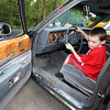 """Cars & Cans Car Show, organized by 16-year-old Alex """"Slimey"""" Lambert of Dracut, to collect food and raise money for the Dracut Food Pantry. Michael O'Grady of Dracut, who turns 11 next Saturday, turns the wheels of a 1985 Buick LeSabre Collectors Edition belonging to Tom Sawyer of Dracut. (SUN/Julia Malakie)"""