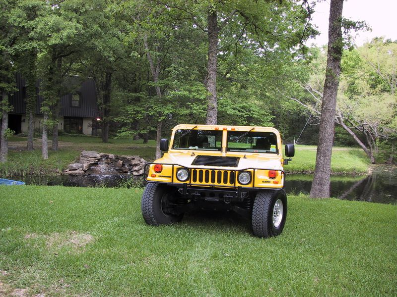 This is my 1997 Fly-Yellow Turbo Diesel Hummer 4-door Hardtop.  The picture was taken out by the pond in front of my Quinlan house which was Monkeystone headquarters for 2 years.