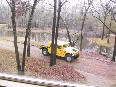 Wintertime picture taken from the 2nd story looking out over the pond with the Hummer in the driveway - you can see how big the place is and that's just the driveway (which circled the pond) and pond.....the rest of the property was HUGE (9 acres).