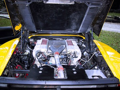 Here's the engine with the turbo going up the center.  I converted the engine from being carbureted to fuel injected which required major work.  $30,000 later and the engine was computer controlled and I could plug a laptop into the engine on the passenger side (inside the car) and adjust air/fuel mixture for all RPM ranges.  Awesome.