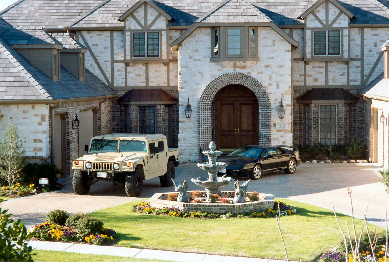 Here's my old house in Stonebriar, located near Frisco, TX.  I started building the house in 1995 and sold it in 1999. That's my 1995 Hummer (gas-powered, not diesel) and my 1995 Lotus S4S.  I had the Lotus for only 2 months before I traded both it and the Hummer for my 1997 Hummer Turbo Diesel in Fly Yellow color!