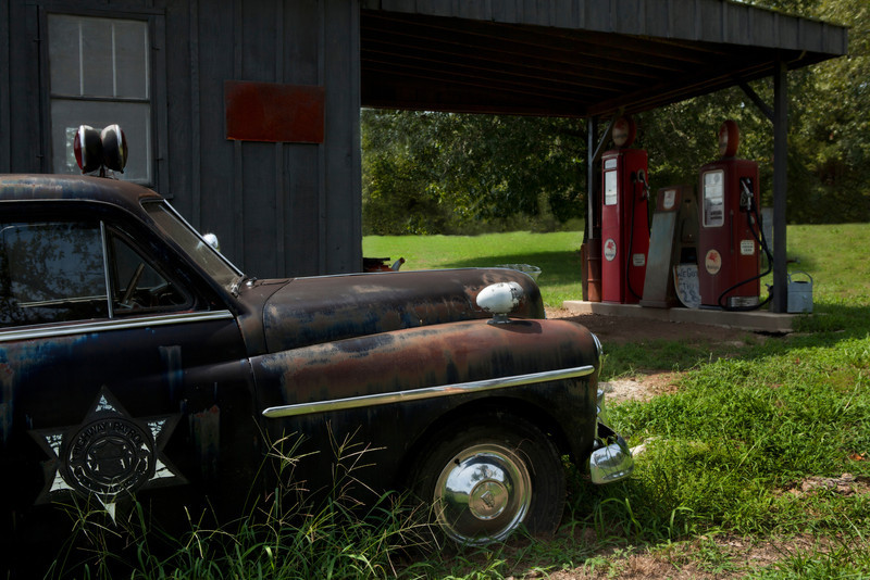 1950 Plymouth Deluxe Patrol Car and old gas station
