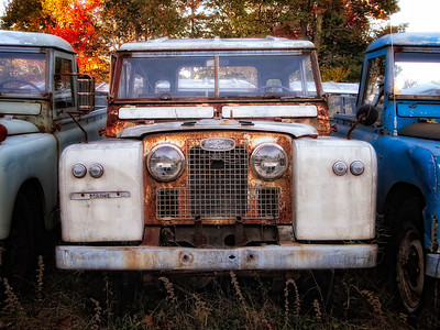 Land Rover Defenders awaiting restoration at the East Coast Rovers storage site in Warren, Maine.