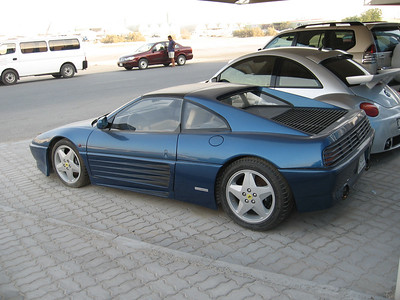 A 1991 346 GTS Ferrari.  The owner abandoned the poor little car about 8 months ago and it's remained, sad, sorry and unloved, outside Quartermile since then. An abandoned Ferrari? Only in Dubai.