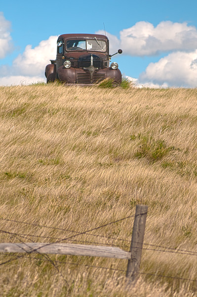 A vintage Dodge pickup sits on a hill near Bear Butte outside of Sturgis, South Dakota.  I drove or rode by that car for years and one day stopped to take a few photos.  The next year, it was gone!