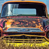 Repainted more than once, a 50's vintage chevy pickup sits in a Morton County pasture.