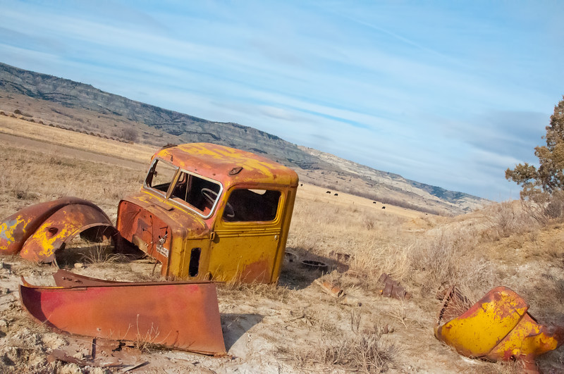 The truck is a 1940's-era Federal Truck.  The company went out of business in 1949.  This truck, parked beneath a bluff in the Badlands, along the Little Missouri River has been stripped of most parts, and left to rust.