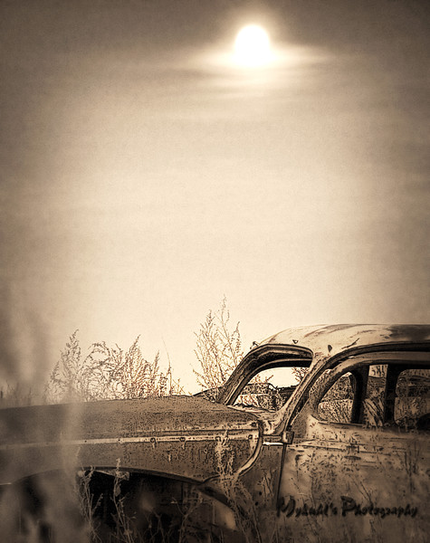 Under a full moon, a 1940-ish vintage Ford rusts away in a North Dakota pasture