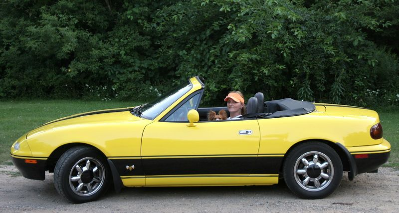1990 Mazda Miata.  Believe it or not... a gift from my best friend.  Her husband restored it just for me!  Wow!