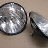 Correct metal-back Guide headlight bulbs.  Expensive!