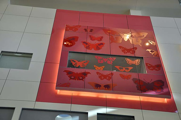 Sunlit, thought-provoking murals are displayed throughout the atrium. Even the glass-enclosed elevator is fun to watch.