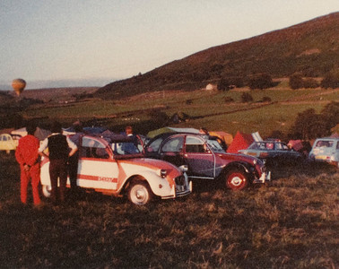 A scan from a low-quality photo (possibly my Kodak disc camera photo, which would explain the quality) in the early 1980s at a meeting of the UK Citroen 2CV club, with a balloon in the background.