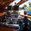 6/19/16 FITCHBURG with story-- A group admires the motor of a built Pontiac GTO during Sundays classic car show at Monty Tech in Fitchburg. photo/Jeff Porter