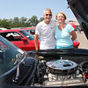 Chris and friend Michelle Novak, now relaxing by his 1963 Vette.