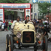 Vintage cars participating in The Great Race arrive in Lowell and park on Middle Street, on their way from Maine to Florida. Navigator Chris Clark of Ansonia, Conn., left, and driver Frank Buonanno of Newtown, Conn. drive down Middle Street in Buonanno's 1915 Hudson Boattail Speedster, the oldest car in the race. (SUN/Julia Malakie)